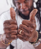 Rasta show thumbs up Stock Photography