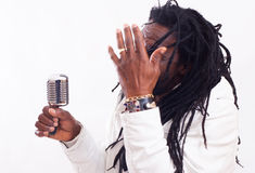 Rasta Singer with microphone Royalty Free Stock Photo