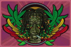 Rasta Tiki Smoking Royalty Free Stock Photos