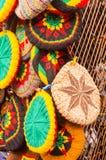 Rastafar beret. Multi colored berets Rastafarian on the stand Royalty Free Stock Photography