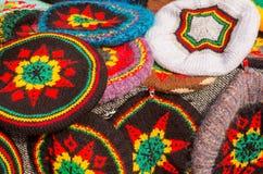 Rastafar beret. Multi colored berets Rastafarian on the stand Stock Photography