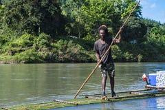 Rastafari rafting on bamboo raft on Rio Grande, Port Antonio, Jamaica royalty free stock photos