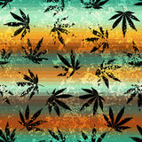 Rastafarian colors pattern and grunge hemp leaves. Royalty Free Stock Photo