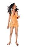 Rastafarian girl. Rasta woman with orange blouse dancing reggae Stock Image