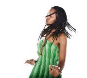 Rastafarian girl. Rasta woman dancing reggae with closed eyes feeling the music Royalty Free Stock Photography