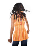 Rastafarian girl. Rasta woman with orange blouse dancing reggae Stock Photography
