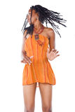 Rastafarian girl. Rasta woman with orange dress dancing reggae Stock Images