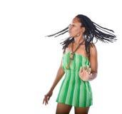 Rastafarian girl. Rasta woman with green dress dancing reggae Royalty Free Stock Photography