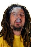 Rastafarian man. Smoking, isolated on white background Stock Photos