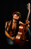 Rastafarian Man With Guitar Stock Photography