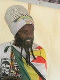 Rastafarian  man  with Zimbabwean  flag. Royalty Free Stock Photo