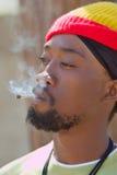 Rastafarian smoking cannabis Royalty Free Stock Photo
