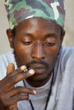 Rastafarian smoking cannabis Royalty Free Stock Images