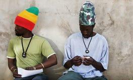 Rastafarian smoking marijuana Stock Images