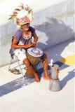 Rastaman in Antigua. Beardy Rastaman playing music  in Antigua, Caribbean royalty free stock photos