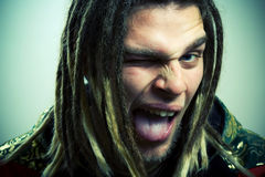 Rastaman put out tongue. Royalty Free Stock Photos