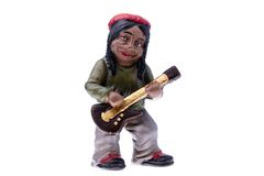 Rastaman Statuette playing bass Stock Photography