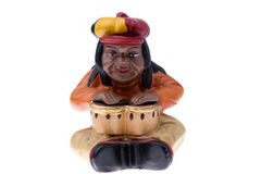 Rastaman Statuette playing bongo Stock Images