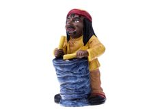 Rastaman Statuette playing konga Stock Images