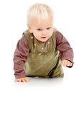 Rastejamentos bonitos pequenos do bebê fotografia de stock royalty free