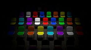 Raster av ljust upplyst för mångfärgade stolar Arkivfoton