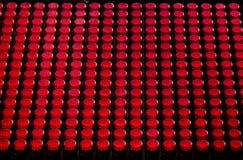Rasterfeld des Rotes Knopf-wie Leuchten Lizenzfreies Stockfoto