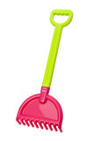 Rastrillo de la playa del juguete (camino de recortes) Imagen de archivo libre de regalías