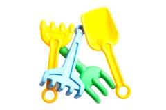 Rastrillos y palas del juguete para la salvadera Fotografía de archivo libre de regalías