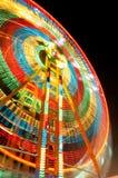 Rastro de giro colorido de la luz de la feria de diversión foto de archivo libre de regalías