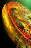 Rastro de giro colorido de la luz de la feria de diversión fotografía de archivo