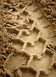 Rastro de neumático en la arena Imagen de archivo libre de regalías