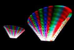 Rastro que brilla intensamente que gira el LED, en la forma de conos Fotos de archivo libres de regalías