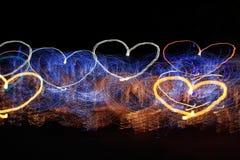 Rastros en forma de corazón de la luz Imagen de archivo