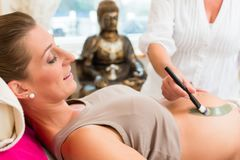 Rasul healing earth therapy for pregnant woman. Rasul therapy for pregnant woman in surgery for far eastern pregnancy wellness Stock Photo