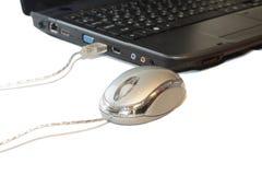 Ratón con la computadora portátil Imágenes de archivo libres de regalías