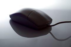 Ratón del ordenador puesto a contraluz Imagenes de archivo