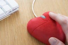 Ratón en forma de corazón del ordenador Imagen de archivo