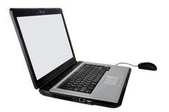 Ratón y computadora portátil Foto de archivo