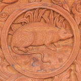 Rat Chinese zodiac animal sign. Wood carving of rat Chinese zodiac animal sign stock photos