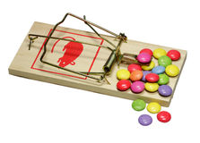 Rat trap. Sweets are attractive on a perilous rat trap Royalty Free Stock Image