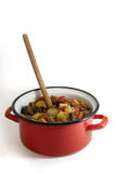Ratatouille. In a red crock pot with a wooden spoon royalty free stock photography