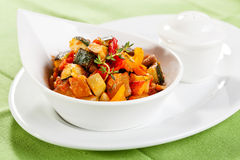 Ratatouille. Traditional vegetable ratatouille on green background royalty free stock image