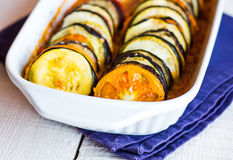 Ratatouille in a baking dish on a white background, horizontally Stock Photography