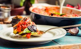 Ratatouille - a classic vegetarian dish from French cuisine. Baked vegetables in tomato sauce with basil and paprika. Comfort veg. Ratatouille - a classic royalty free stock photography