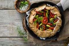 Ratatouille galette pie on rustic background. Copy space royalty free stock photos