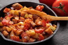 Ratatouille in an iron pan. On a rustic table Royalty Free Stock Photography