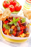 Ratatouille for lunch. Traditional vegetable ratatouille with baguette for lunch stock images