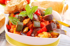 Ratatouille for lunch. Traditional vegetable ratatouille with baguette for lunch stock photos