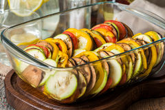 Ratatouille - traditional French Provencal vegetable dish. In glass brazier on wooden cutting board royalty free stock photo