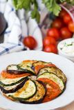Ratatouille, vegetables cut on slices, eggplant, zucchini, tomat Royalty Free Stock Photo